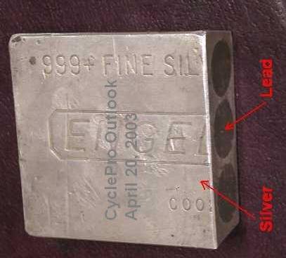 A 'drilled-and-filled' 100 ounce (oz) Engelhard silver bar, with three (3) drill holes filled with lead, cut in half.