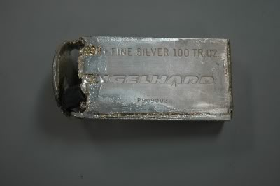 A hollowed-out 100 ounce (oz) Engelhard silver bar, that had been partially melted when it the lead insides were discovered, view from the top.